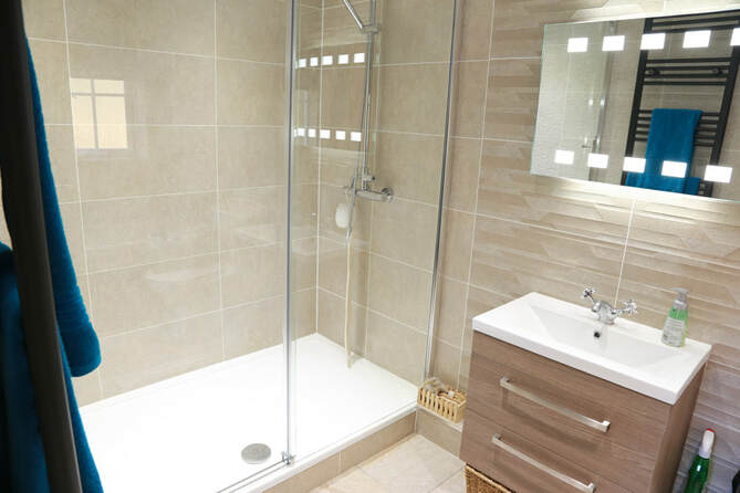 Fitted bathroom shower cubicle