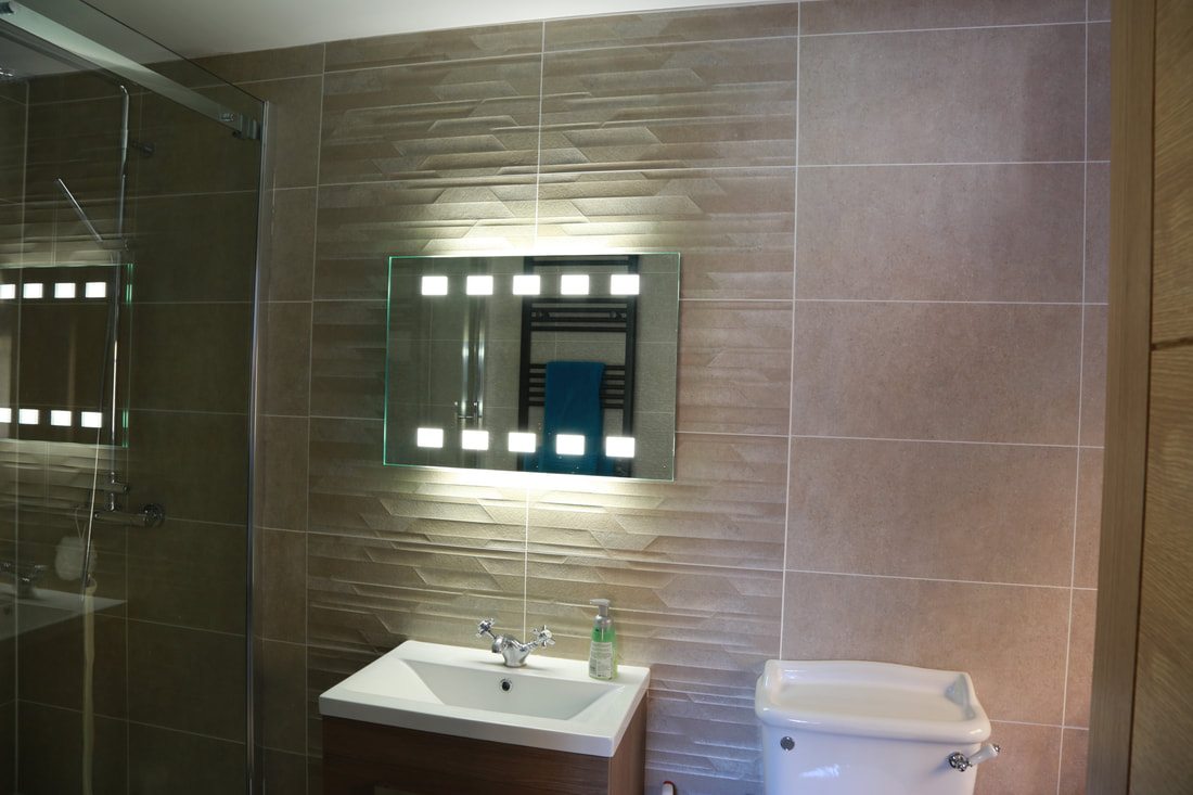 Fitted bathroom tiles and mirror